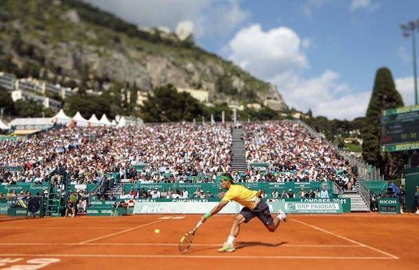 PICTURE TAKEN WITH TILT AND SHIFT LENS Spain's Rafael Nadal hits a return to his opponent Ivan Ljubicic of Croatia during the Monte-Carlo ATP Masters Series Tournament tennis match, on April 15, 2011 in Monaco. Nadal won 6-1, 6-3. AFP PHOTO VALERY HACHE (Photo credit should read VALERY HACHE/AFP/Getty Images)